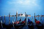 Gondolas point to the church of San Giorgio Maggiore across the Grand Canal in Venice, Italy