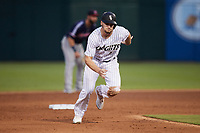 Adam Engel (15) of the Charlotte Knights takes off for third base during the game against the Nashville Sounds at Truist Field on June 4, 2021 in Charlotte, North Carolina. (Brian Westerholt/Four Seam Images)