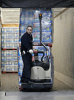 Paul Cortez unloads a truck at a Costco Wholesale Warehouse Friday, March 9, 2007 in Columbus, Ohio.