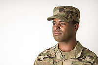 African American US military soldier in uniform in the studio with white background. For sale as stock photography, DOD compliant.
