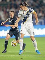 CARSON, CA - SEPTEMBER 15: Zlatan Ibrahimovic #9 of the Los Angeles Galaxy moves with the ball during a game between Sporting Kansas City and Los Angeles Galaxy at Dignity Health Sports Complex on September 15, 2019 in Carson, California.