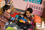 Education Preschool 3-4 year olds pretend play two boys laughing covered with shawl horzontal