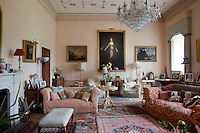 A romantic 18th century portrait of a lady presides over the pastel coloured living room