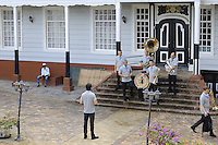Kleintje Pils ( www.kleintjepils.nl ) typical Dutch band members preparing to pose with their self on the steps of BISDOM Paramaribo courtyard.....Blessing and First Worship of ST. Petrus and Paulus Cathedral (AKA World's largest wooden cathedral)