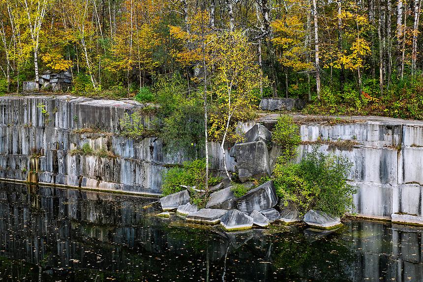 Granite quarry with autumn color, Dorset, Vermont, USA.