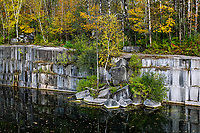 Granite quarry with autumn color, Dorset, Vermont, USA.