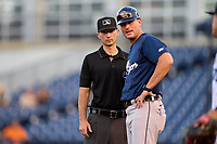 Umpire Michael Corbett listens to an argument from manager Andrew Graham (17) during a game between the Lakeland Flying Tigers and Tampa Tarpons on July 15, 2021 at George M. Steinbrenner Field in Tampa, Florida.  (Mike Janes/Four Seam Images)