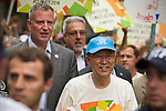 Ban Ki-Moon (R) secretary General of the United Nations walks with New York Mayor, Bill de Blasio, during the Peoples Climate March in New York city. More than 300,000 march in solidarity for Climate accountability, at the People's Climate March on September 21, 2014. (Credit: Robert van Waarden)
