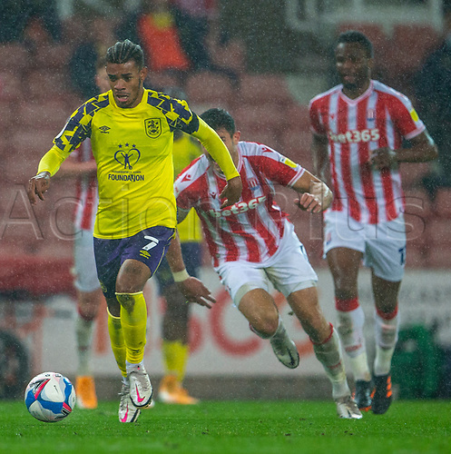21st November 2020; Bet365 Stadium, Stoke, Staffordshire, England; English Football League Championship Football, Stoke City versus Huddersfield Town; The rain falls as Juninho Bacuna of Huddersfield Town comes forward