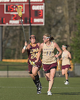 Lauren Costello  (BC 11) brings the ball forward as Stephanie Sumcizk (I 24) defends. Boston College defeated Iona College, 19-5.