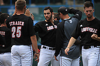 University of Louisville Cardinals outfielder Jeff Gardner (42) is greeted by team mates after he hits a home run during a game against the Temple University Owls at Campbell's Field on May 10, 2014 in Camden, New Jersey. Temple defeated Louisville 4-2.  (Tomasso DeRosa/ Four Seam Images)