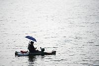 Dan Kilgore of Prairie Grove fishes Monday Aug. 2, 2021 at Lake Fayetteville. Kilgore improvised an umbrella holder for shade while fishing.  Visit nwaonline.com/21000803Daily/ and nwadg.com/photo. (NWA Democrat-Gazette/J.T. Wampler)
