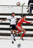 Stephanie Lopez (L) goes up for a header with Han Duan (R) during a Algarve Women´s Cup soccer match between USA and China at the Silves Stadium in Silves, Portugal, March 7, 2007.