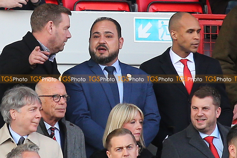 Charlton's new Chairman, Matt Southall (Top, far right) looks down at the pitch while new owner, His Excellency Tahnoon Nimer on his first visit to see a match at Charlton listens to the gentleman next to him during Charlton Athletic vs Barnsley, Sky Bet EFL Championship Football at The Valley on 1st February 2020