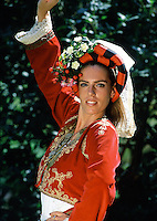 Portrait of a female greek dancer in traditional dress. Greece.