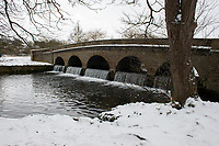 A general view of the footbridge over the lake following snowfall at Foots Cray Meadow, Sidcup, Kent, England on the 9 February 2021. Photo by Alan Stanford.