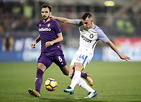 Calcio, Serie A: Fiorentina - Inter, stadio Artemio Franchi Firenze 5 gennaio 2018.<br /> Inter's Ivan Perisic (r) in action with Fiorentina's Milan Badelj (s)during the Italian Serie A football match between Fiorentina and Inter Milan at Florence's Artemio Franchi stadium, January 5 2018.<br /> UPDATE IMAGES PRESS/Isabella Bonotto
