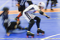 15 MAR 2014 - BIRMINGHAM, GBR - Team USA jammer Jonathan R (in white, blue and red) races past a Power or Scotland blocker during the bout between the two countries at the inaugural Men's Roller Derby World Cup in the Futsal Arena in Birmingham, West Midlands, Great Britain (PHOTO COPYRIGHT © 2014 NIGEL FARROW, ALL RIGHTS RESERVED)