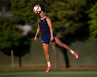 KASHIMA, JAPAN - AUGUST 1: Carli Lloyd #10 of the USWNT heads the ball during a training session at the practice field on August 1, 2021 in Kashima, Japan.