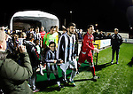Llandudno 2 Denbigh Town 2, 20/03/2015. Maesdu Park, Huws Gray Alliance Football League. The teams emerge from the tunnel. Needing a win to guarantee promotion to the top division of Welsh football for the first time, Llandudno took the lead twice, but were held to a draw against Denbigh Town.<br /> Llandudno installed an artificial 3G pitch in 2014. The pitch is available for hire, and enables to club to have an active community programme, and teams in every age range, all playing at Maesdu Park. Photo by Paul Thompson.