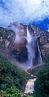 940000011 panoramic view of angel falls the tallest waterfalll in the world and flowing down from auyan tepui one of the sky islands rise up from the clouds and tropical rain forest in the wild and remote kost world portion of canaima national park in venezuela