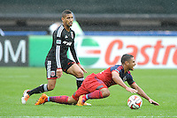 Washington, D.C.- March 29, 2014. Quincy Amarikwa of the Chicago Fire gets fouled by Sean Franklin (5) of D.C. United . The Chicago Fire tied D.C. United 2-2 during a Major League Soccer Match for the 2014 season at RFK Stadium.