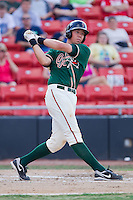 Kyle Skipworth #11 of the Greensboro Grasshoppers follows through on his swing against the Hickory Crawdads at  L.P. Frans Stadium July 10, 2010, in Hickory, North Carolina.  Photo by Brian Westerholt / Four Seam Images