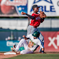 29 July 2018: Batavia Muckdogs infielder Demetrius Sims doubles off a sliding Vermont Lake Monster Joseph Pena in the 5th inning at Centennial Field in Burlington, Vermont. The Lake Monsters defeated the Muckdogs 4-1 in NY Penn League action. Mandatory Credit: Ed Wolfstein Photo *** RAW (NEF) Image File Available ***