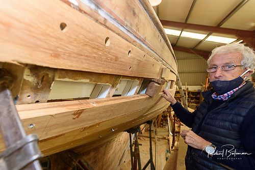 Dick Gibson showing how the over-worn topside planking has been replaced by double-skin iroko