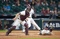 Nick Slaughter (38) of the Houston Cougars is tagged out by Mississippi State Bulldogs catcher Dustin Skelton (8) as he tries to steal home in game six of the 2018 Shriners Hospitals for Children College Classic at Minute Maid Park on March 3, 2018 in Houston, Texas. The Bulldogs defeated the Cougars 3-2 in 12 innings. (Brian Westerholt/Four Seam Images)