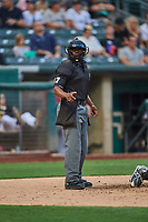 Umpire Malachi Moore handles the calls behind the plate during the game between the Salt Lake Bees and the El Paso Chihuahuas at Smith's Ballpark on August 13, 2018 in Salt Lake City, Utah. Salt Lake defeated El Paso 4-3. (Stephen Smith/Four Seam Images)