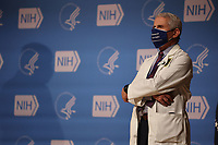 Dr. Anthony Fauci listens as President Joe Biden talks to staff at the National Institutes of Health on Thursday, February 11, 2021 in Bethesda, Maryland. <br /> (Photo by Oliver Contreras/SIPA USA)<br /> CAP/MPI/RS<br /> ©RS/MPI/Capital Pictures