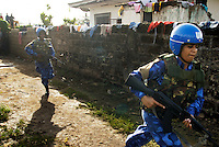 LIBERIA, Monrovia, 10/04/2007..Members of the unit conduct a cordon and search operation in Monrovia. Several suspects are apprehended after drugs (marijuana and herion) are found on the premises...© 2007 Aubrey Wade. All rights reserved.