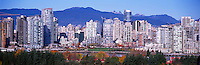 "City of Vancouver Skyline and Downtown at Yaletown and ""False Creek"", BC, British Columbia, Canada, in Autumn / Fall.  The North Shore Mountains (Coast Mountains) rise above the City. - Panoramic View"