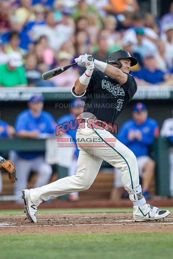 Coastal Carolina Chanticleers designated hitter G.K. Young (37) follows through on his swing against the Florida Gators in Game 4 of the NCAA College World Series on June 19, 2016 at TD Ameritrade Park in Omaha, Nebraska. Coastal Carolina defeated Florida 2-1. (Andrew Woolley/Four Seam Images)