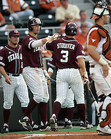 Texas DH Darby Brown greets Blake Stouffer after he scores against Texas on May 16th, 2008 in Austin Texas. Photo by Andrew Woolley / Four Seam images.