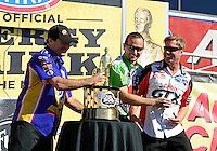 Nov. 11, 2012; Pomona, CA, USA: NHRA funny car driver Jack Beckman (center) picks up Mike Neff (right) while Ron Capps grabs the championship trophy during the Auto Club Finals at at Auto Club Raceway at Pomona. Mandatory Credit: Mark J. Rebilas-