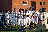 Michigan Wolverines bench celebrates the ninth inning action against the Michigan State Spartans on March 21, 2021 in NCAA baseball action at Ray Fisher Stadium in Ann Arbor, Michigan. Michigan scored 8 runs in the bottom of the ninth inning to defeat the Spartans 8-7. (Andrew Woolley/Four Seam Images)
