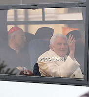 "Pope Benedict XVI (C), Vatican's State Secretary Cardinal Tarcisio bertone  arrive in a bus at Santa Maria degli Angeli's basilica (St Mary of the Angels) to attend the interreligious talks on October 27, 2011. Pope Benedict XVI will lead during the day the 25th Interreligious talks, a ""journey of reflection, dialogue and prayer for peace and justice in the world"" held in St. Francis of Assisi's birthplace,"