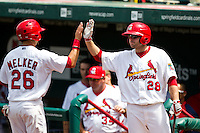 Chris Swauger (28) of the Springfield Cardinals high fives teammates during a game against the Arkansas Travelers at Hammons Field on May 8, 2012 in Springfield, Missouri. (David Welker/ Four Seam Images)
