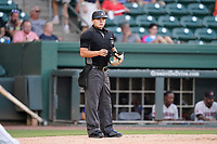 Umpire Hector Cuellar works a game between the Hickory Crawdads and the Greenville Drive on Tuesday, August 24, 2021, at Fluor Field at the West End in Greenville, South Carolina. (Tom Priddy/Four Seam Images)
