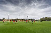 Players warm up at Fairwood Training Ground, near Swansea, Wales, UK.
