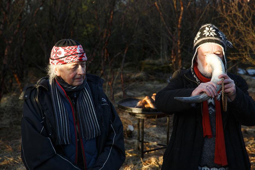 Eyvindur P. Eiríksson and Hilmar Örn Hilmarsson drink to the deities at the solar eclipse.