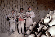 In Egypt, these children work in a pottery, producing plates, bowls, and pots. - Child labor as seen around the world between 1979 and 1980 - Photographer Jean Pierre Laffont, touched by the suffering of child workers, chronicled their plight in 12 countries over the course of one year.  Laffont was awarded The World Press Award and Madeline Ross Award among many others for his work.