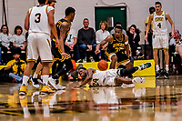 16 March 2019: University of Vermont Catamount Guard Ben Shungu, a Redshirt Sophomore from Burlington, VT, is pushed to the court as UMBC Retriever Forward Arkel Lamar, a Junior from Bridgeport, CT, looks on in the first half against the UMBC Retrievers in the America East Championship Game at Patrick Gymnasium in Burlington, Vermont. The Catamounts defeated the Retrievers 66-49, avenging their loss against the same team in last years' Championship Game. Mandatory Credit: Ed Wolfstein Photo *** RAW (NEF) Image File Available ***