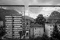 Switzerland. Canton Ticino. Viganello. Rainy day on balcony's glass walls. Heavy rain in the street and on the various buildings. Viganello is a quarter of the city of Lugano. 17.06.2020  © 2020 Didier Ruef