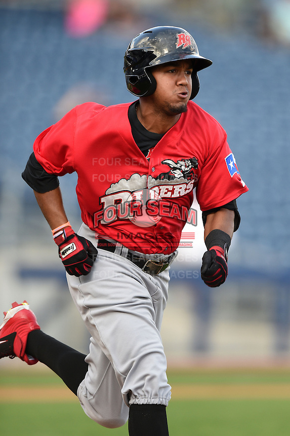 Frisco Rough Riders outfielder Teodoro Martinez (28) runs to first during the first game of a doubleheader against the Tulsa Drillers on May 29, 2014 at ONEOK Field in Tulsa, Oklahoma.  Frisco defeated Tulsa 13-4.  (Mike Janes/Four Seam Images)