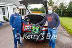 John Halpin (left) and Adrian Collins getting ready to do deliveries for the Duagh GAA on Sunday.