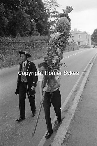 Glove is Up, Honiton, Devon England. 1973. Town Crier Tom Lake, his brother  Joe Lake who carries the Glove Is Up pole into town.