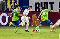 CARSON, CA - SEPTEMBER 27: Seattle Sounders teammates and brothers  Alex Roldan #16 and Cristian Roldan #7 defend against an approaching Cristian Pavon #10 of the Los Angeles Galaxy during a game between Seattle Sounders FC and Los Angeles Galaxy at Dignity Heath Sports Park on September 27, 2020 in Carson, California.
